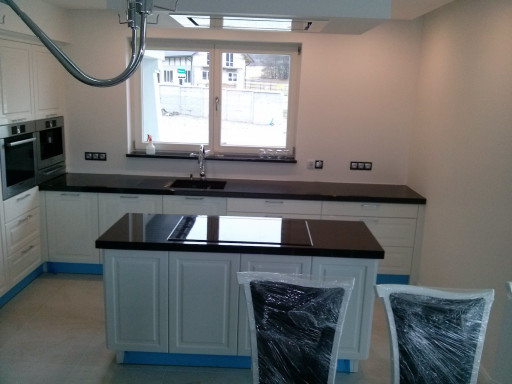 KITCHEN made of polished absolute black granite with 6 cm subframe