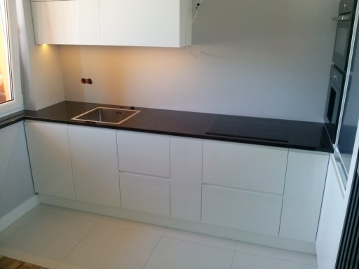 KITCHEN made of polished absolute black granite