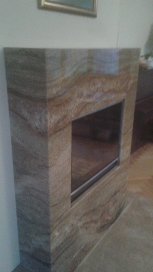 FIREPLACE made of polished imperial gold granite