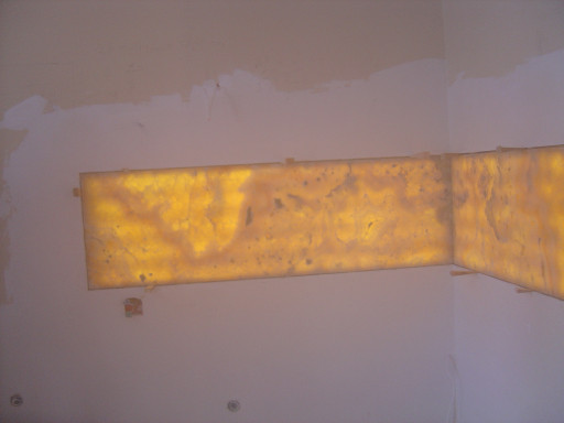 Wall made of ONYX illuminated with LED lights.
