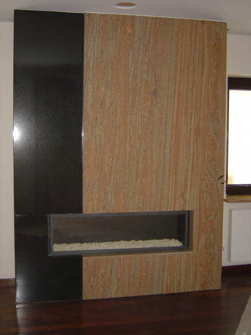 FIREPLACE made of absolute black and raw silk granite