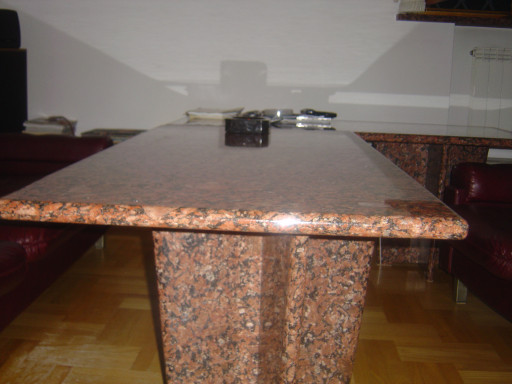 ALL TABLE made of red granite
