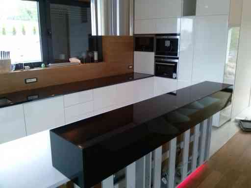 KITCHEN made of absolute black granite combined with vega quartzite