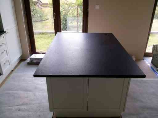 KITCHEN made of brushed angola black granite