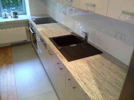 KITCHEN made of river white granite extended to 4 cm