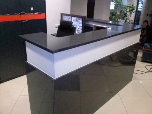 RECEPTION DESK made of polished padang dark granite