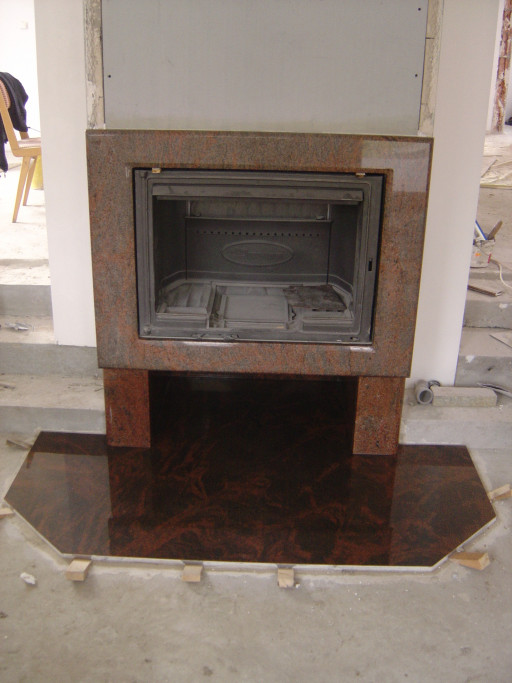 FIREPLACE elements made of multicolour red granite