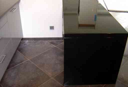 KITCHEN made of polished absolute black granite extended to 10 cm