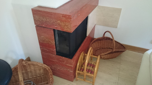 FIREPLACE made of rosso persiano travertine