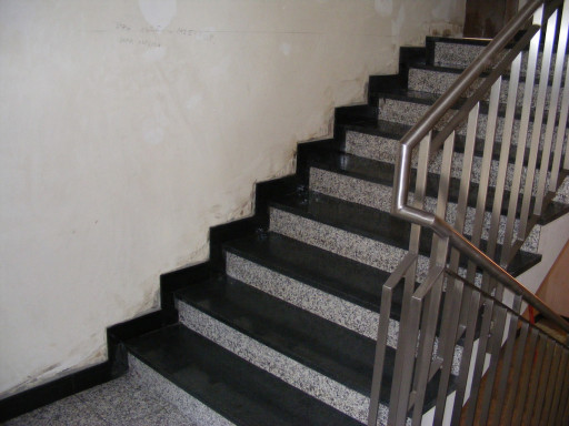 STAIRCASES: threads are made of pedant dark granite and stair risers of pedra vella granite