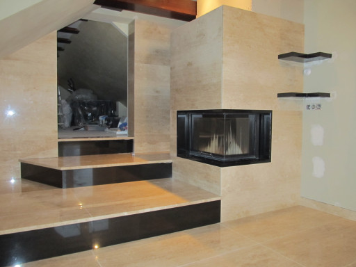 STAIRCASE made of breccia marble and the stair risers of black granite