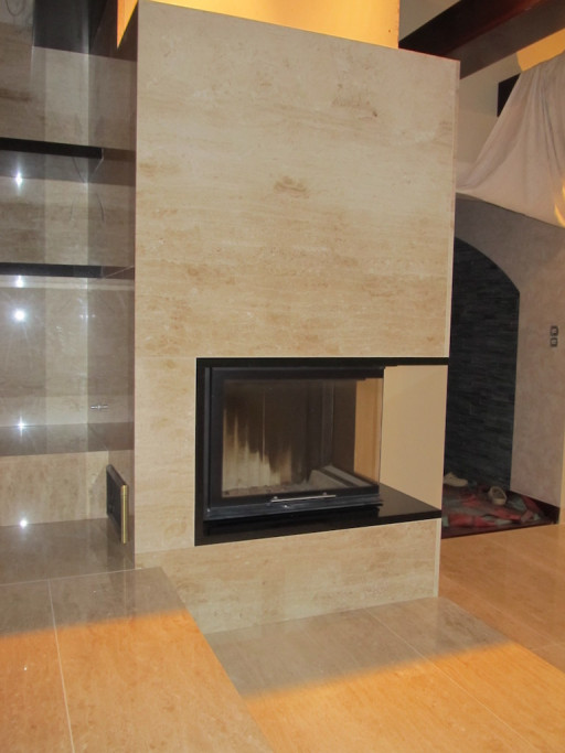 FIREPLACE made of breccia marble combined with elements of absolute black granite