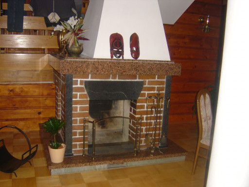 FIREPLACE made of red and black granite