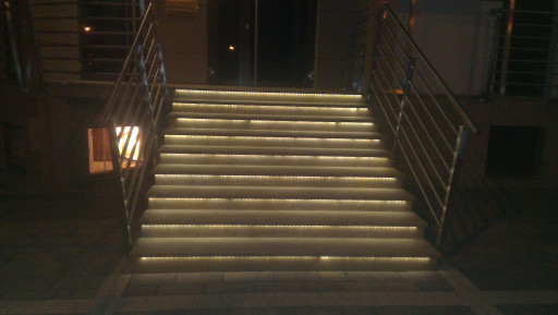 STAIRCASE made of light granite with LED lighting